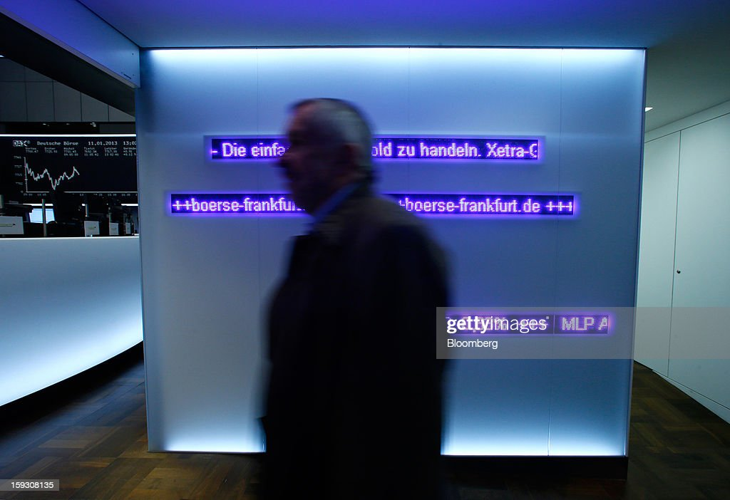 A trader enters the trading floor of the Frankfurt Stock Exchange in Frankfurt, Germany, on Friday, Jan. 11. 2013. European stocks pared their decline as Italy's borrowing costs dropped at a debt sale, offsetting concern that China has less room for monetary easing after a reported showed inflation increased more than estimated. Photographer: Ralph Orlowski/Bloomberg via Getty Images