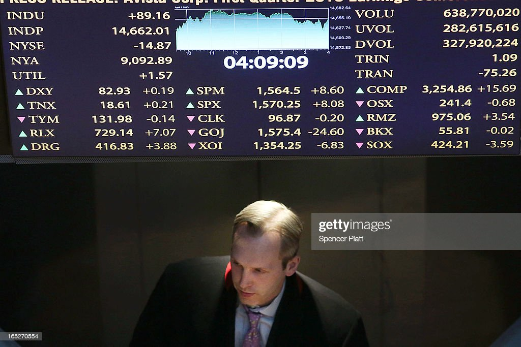 A trader exits the floor of the New York Stock Exchange at the end of the trading day on April 2, 2013 in New York City. The Dow Jones Industrial average and the S&P 500 rose to new record highs on April 2, with the Dow finishing at a record close of 14,662. All three major indexes are up between about 10 percent and 12 precent for the year.