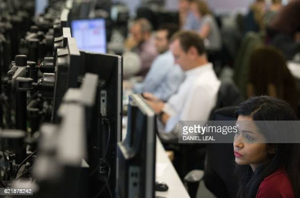 A trader from ETX Capital works in central London on November 9 following the result of the US presidential election Global stock markets sank...