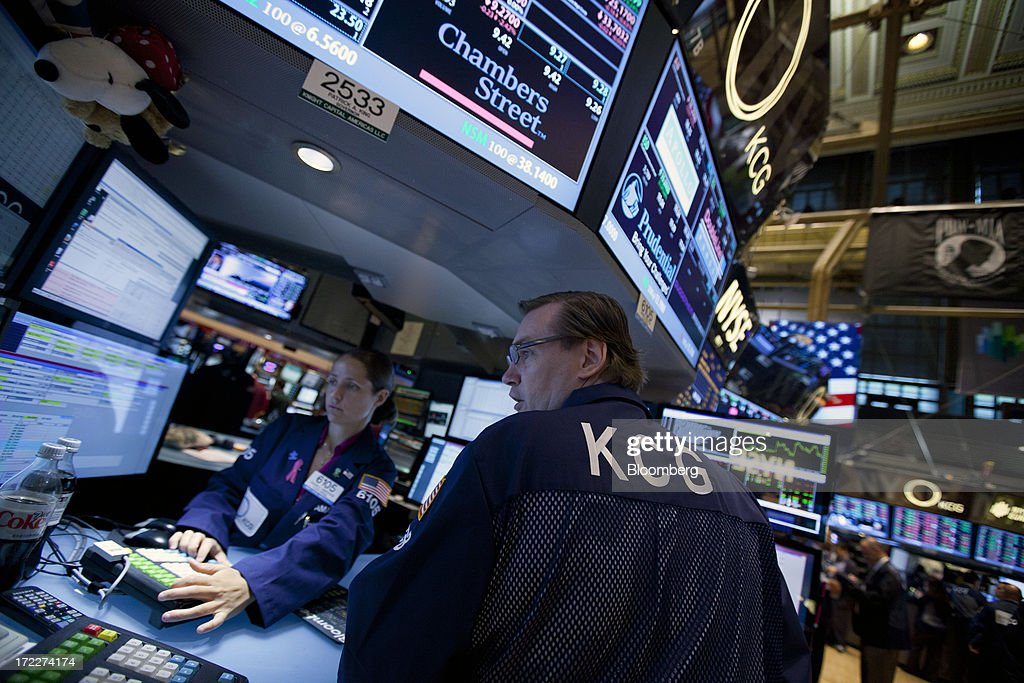 A trader from KCG Holdings Inc., the new company formed by the merger between Getco LLC and Knight Capital Group Inc., works at the New York Stock Exchange (NYSE) in New York, U.S., on Tuesday, July 2, 2013. Getco LLC and Knight Capital Group Inc. completed their merger, creating a public company that will play one of the biggest roles in the daily functioning of the U.S. stock market. The new company, KCG Holdings Inc., began trading today at the NYSE. Photographer: Jin Lee/Bloomberg via Getty Images