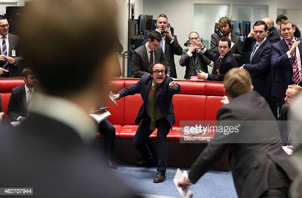 A trader gestures from inside the open outcry pit as he works on the trading floor the London Metal Exchange in London UK on Tuesday Feb 3 2015 The...