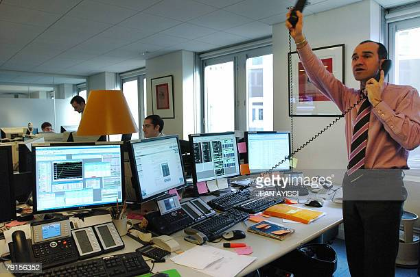 A trader gestures while phoning at the independant private banking company Meeschaert Gestion Privee 22 January 2008 in Paris The French stock market...