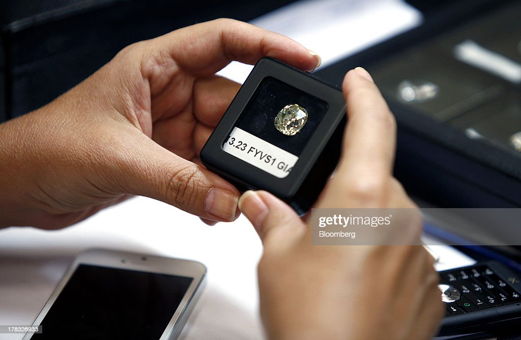 A trader holds a large cut diamond gemstone for sale at a trade fair during International Diamond Week at the Israel Diamond Centre in Ramat Gan, Israel, on Wednesday, Aug. 28, 2013. Diamond prices rose to $7,992 this week from $7,962 a week earlier, according to the Rapaport Diamond Trade Index. Photographer: Ariel Jerozolimski/Bloomberg via Getty Images
