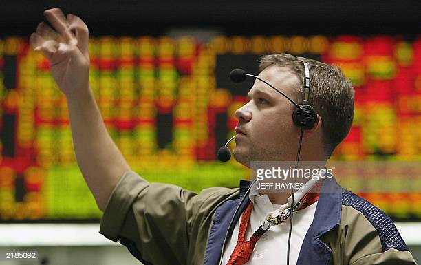 A trader in the 10 year note pit at the Chicago Board of Trade deals 22 July 2003 in Chicago US Treasuries rose in trading as a month long rout that...