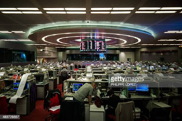 A trader is seen at the stock exchange in Hong Kong on April 10 2014 China unveiled a plan on April 10 allowing crosstrading between Hong Kong and...