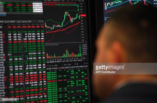 A trader is seen on the floor of the NYSE after Ferrari NV led by Chairman Sergio Marchionne and members of the companys leadership team ring the...