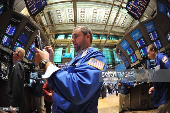 Trader Kevin Lodewick Jr of Quattro M Securities Inc works on the floor of the New York Stock Exchange just after the opening bell August 5 2011 The...