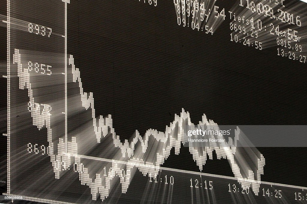 A trader looks up at the board displaying the day's course of the DAX stock market index at the Frankfurt Stock Exchange on February 11, 2016 in Frankfurt, Germany. Stock markets across the globe have been exceptionally volatile in recent weeks as investors fear a global economic slowdown.