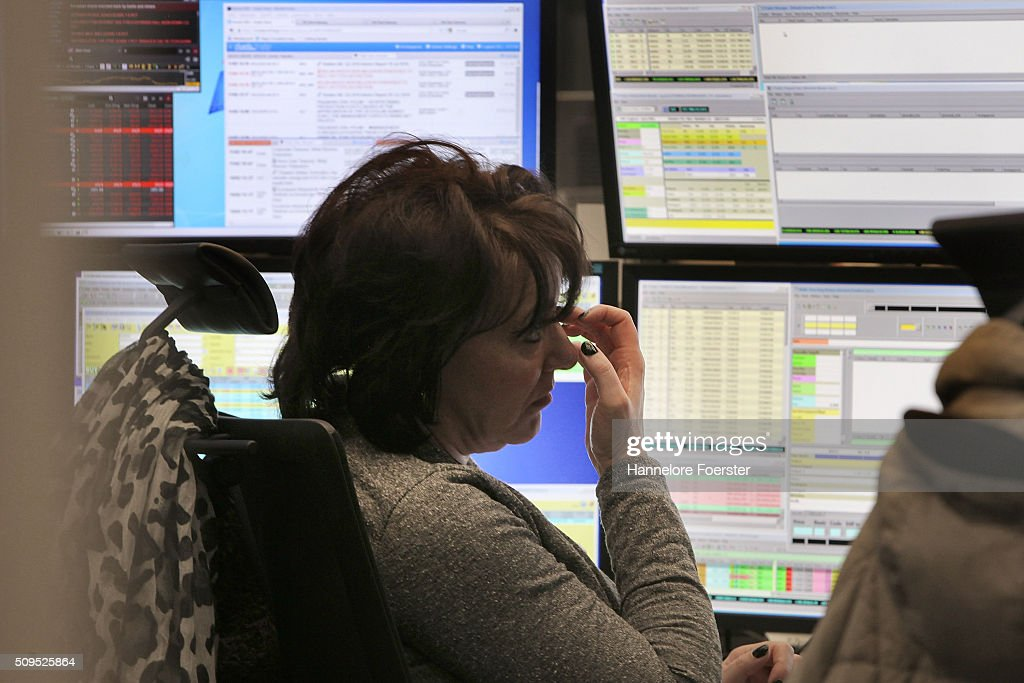 A trader looks up to her monitor of the DAX stock market index at the Frankfurt Stock Exchange on February 11, 2016 in Frankfurt, Germany. Stock markets across the globe have been exceptionally volatile in recent weeks as investors fear a global economic slowdown.
