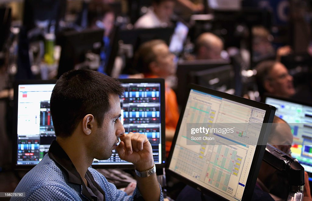 A trader monitors the markets in the CBOE Volatility Index (VIX) pit at the Chicago Board Options Exchange (CBOE) following the Federal Open Market Committee meeting on December 12, 2012 in Chicago, Illinois. The Fed announced today that they expect to keep key short-term interest rates at or near zero percent as long as the unemployment rate remains above 6.5 percent. William Brodsky, Chairman and CEO of the CBOE, said that he will step down as CEO following the 2013 Annual Meeting.