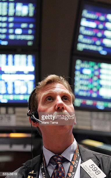 A trader on the floor of the New York Stock Exchange awaits the announcement on interest rates by the Federal Reserve August 9 2005 in New York City...