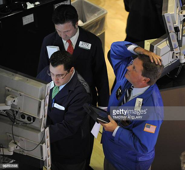 A trader on the floor of the New York Stock Exchange looks at stocks during the final minutes of trading May 6 2010 as the Dow lost almost 1000...