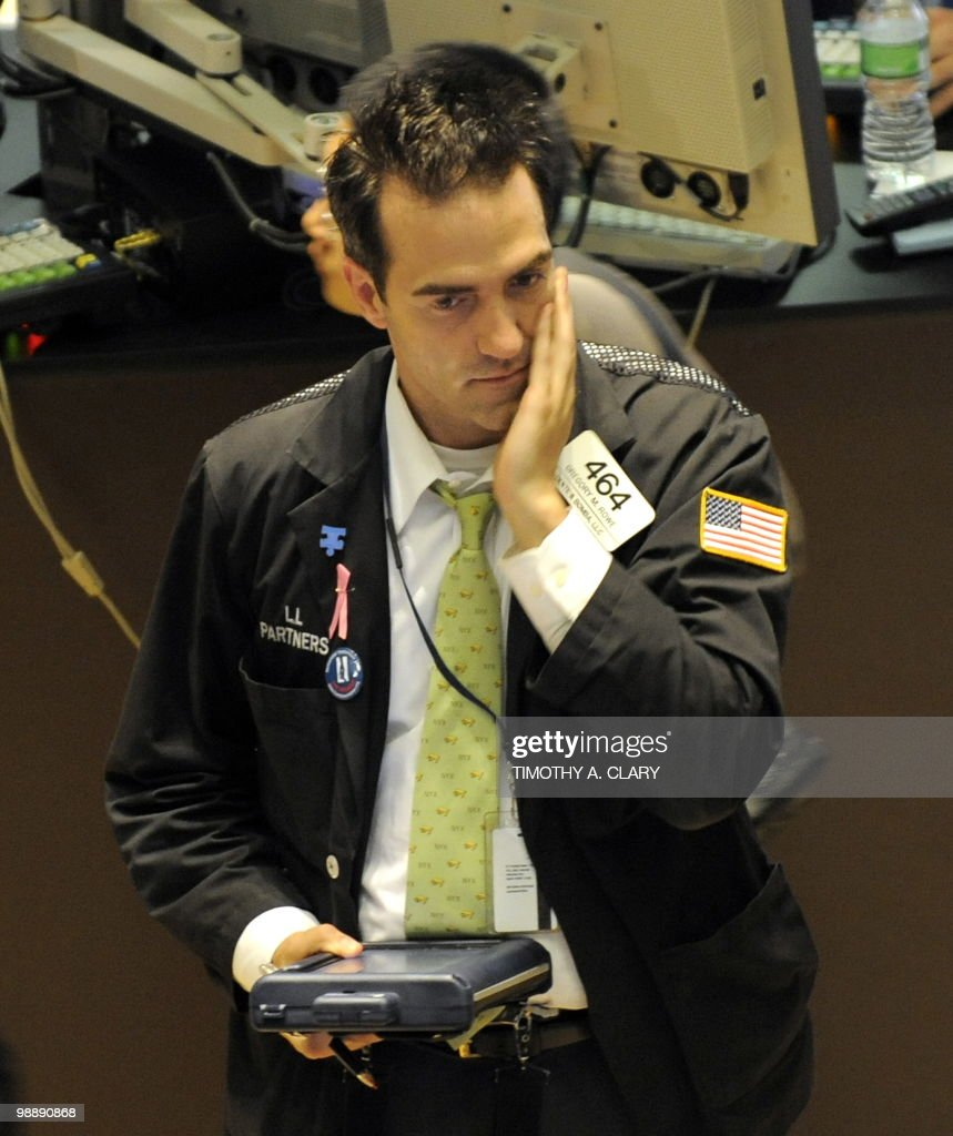 A trader on the floor of the New York Stock Exchange looks at stocks during the final minutes of trading May 6, 2010 as the Dow lost almost 1,000 points before recovering to a loss of 505 as traders watched protests in the streets of Athens.