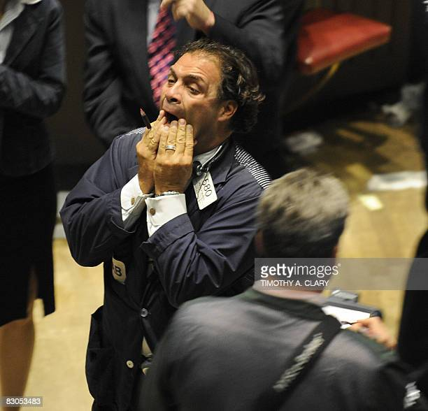 A trader on the floor of the New York Stock Exchange looks up at the numbers on the board September 29 2008 Wall Street bluechip stocks suffered...