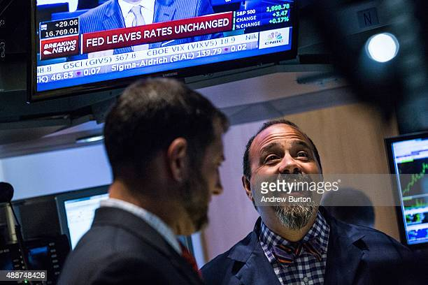 A trader on the floor of the New York Stock Exchange reacts to news that the Federal Reserve decided to not raise interest rates on September 17 2015...