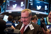 A trader on the floor of the New York Stock Exchange works as Twitter's initial price offering is finalized on November 7 2013 in New York City...