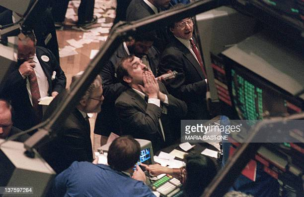 A trader on the New York Stock Exchange looks at stock rates 19 October 1987 as stocks were devastated during one of the most frantic days in the...