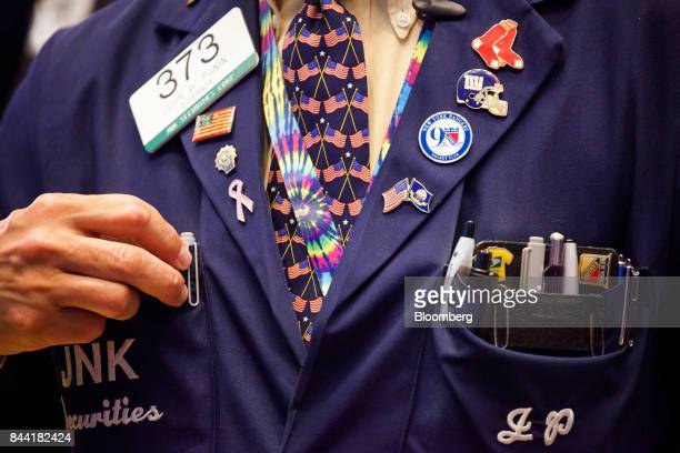A trader places a pen in his pocket on floor of the New York Stock Exchange in New York US on Friday Sept 8 2017 The dollar fell to the weakest in...