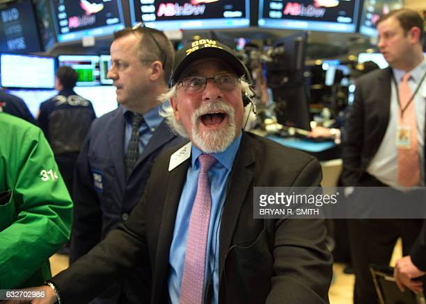 A trader reacts as the Dow Jones closes above 20000 for the first time at the New York Stock Exchange January 2017 in New York The Dow Jones...