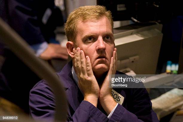 A trader rubs his face on the floor of the New York Stock Exchange in New York US on Friday Oct 3 2008 US stocks slid capping the worst week for the...