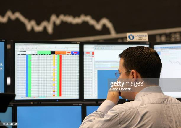 A trader rubs his nose during a trading session on the trading floor at Frankfurt stock exchange on September 15 2008 in Frankfurt Germany Due to...