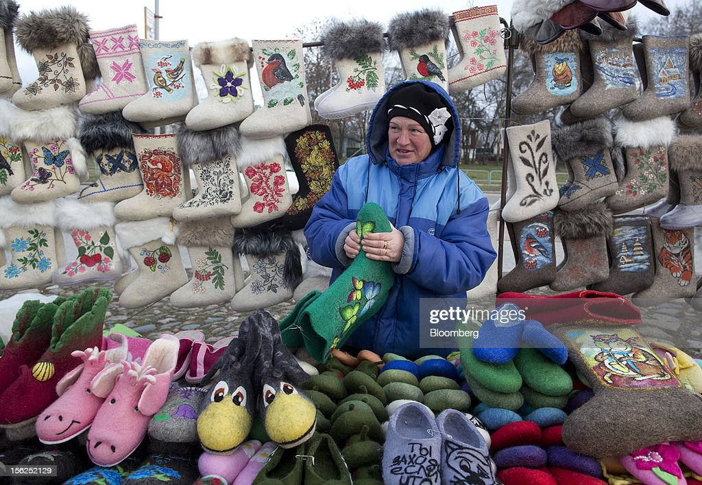A trader sells traditional felt boots, or Valenki, from a stall at a street market in Suzdal, Russia, on Sunday, Nov. 11, 2012. Russia has one of the world's lowest retirement ages, set in 1932 during the Stalin era. Photographer: Andrey Rudakov/Bloomberg via Getty Images