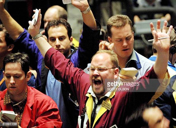 A trader signals a trade in the Dow Jones Industrial Average stock index futures pit at the Chicago Board of Trade 14 March 2001 The DJIA cash index...