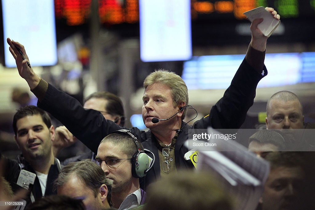 A trader signals an offer in the corn options pit at the CME Group March 15, 2011 in Chicago, Illinois. U.S. stock and commodity prices tumbled today following a sharp drop in Japan's stock market, as investors worldwide worry about the economic impact of that country's recent earthquake, tsunami and unfolding nuclear crisis.