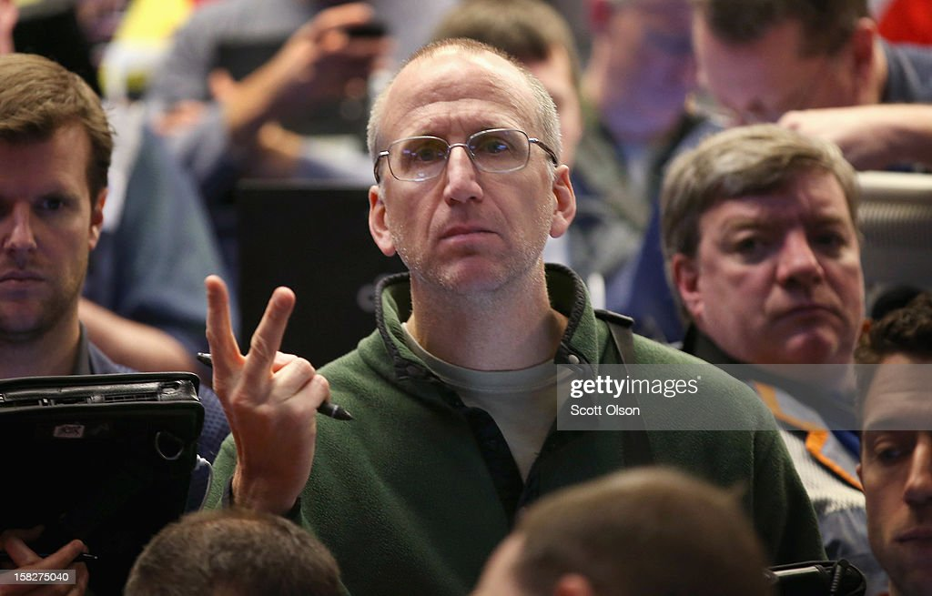 A trader signals an offer in the Standard & Poor's 500 stock index options pit at the Chicago Board Options Exchange (CBOE) following the Federal Open Market Committee meeting on December 12, 2012 in Chicago, Illinois. The Fed announced today that they expect to keep a key short-term interest rates at or near zero percent as long as the unemployment rate remains above 6.5 percent. William Brodsky, Chairman and CEO of the CBOE, said that he will step down as CEO following the 2013 Annual Meeting.