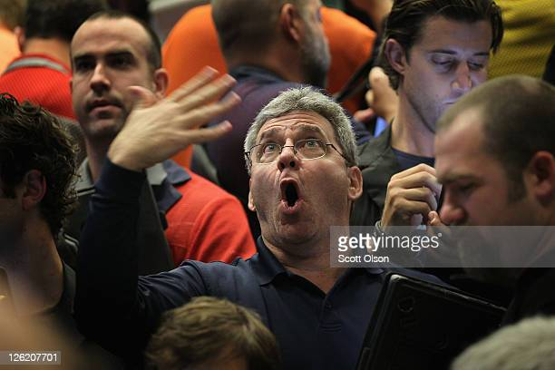 A trader signals an offer on Standard Poor's 500 stock index options at the Chicago Board Options Exchange on September 23 2011 in Chicago Illinois...