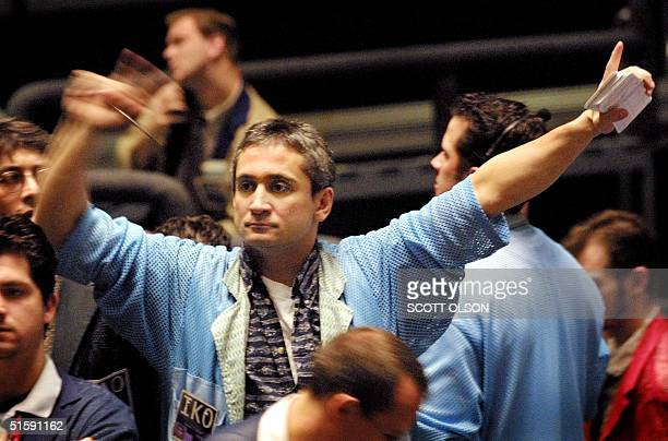 A trader signals prices in the Dow Jones Industrial Average stock index futures pit at the Chicago Board of Trade 14 March 2001 The DJIA cash index...