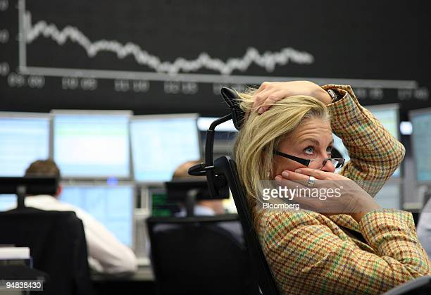 Trader Simone Wallmeyer works at the Frankfurt Stock Exchange in Frankfurt Germany on Monday Oct 6 2008 Stocks tumbled around the world the euro fell...