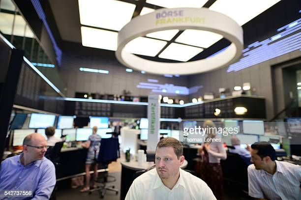 Trader sit at their desks at the Frankfurt Stock exchange the day after a majority of the British population voted for leaving the European Union on...