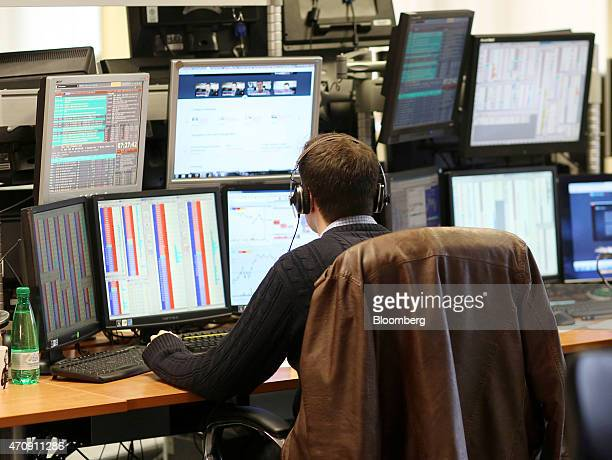 A trader sits and monitors his computer screens as he trades on the financial markets from the offices of Futex Co in Woking UK on Friday April 24...