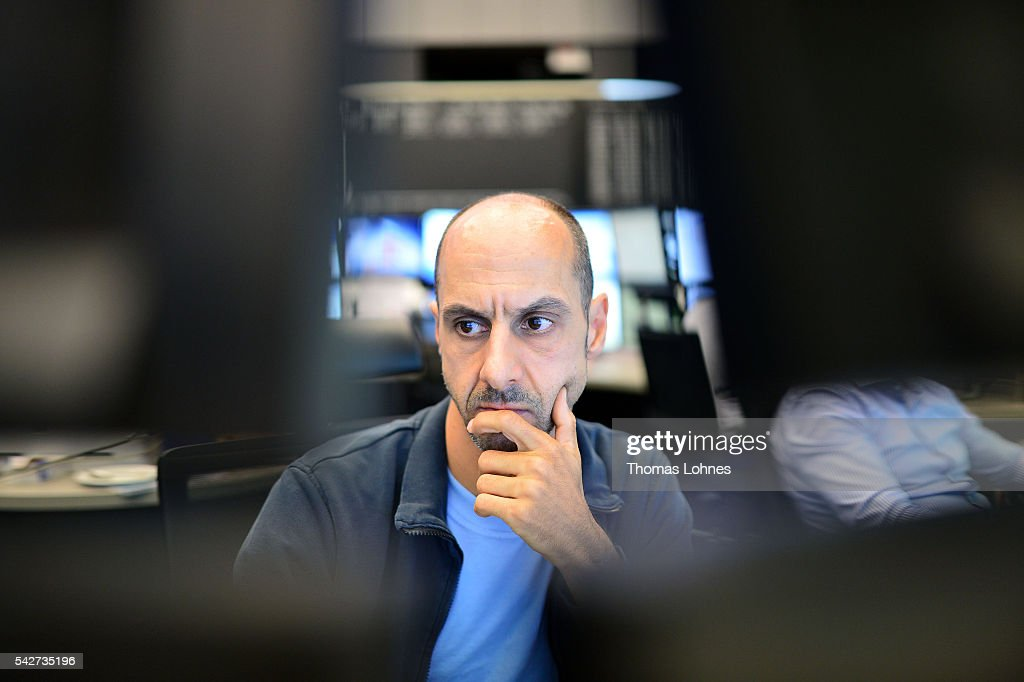 A trader sits at his desk at the Frankfurt Stock exchange the day after a majority of the British public voted for leaving the European Union on June 24, 2016 in Frankfurt am Main, Germany. Many prominent corporate CEOs and leading economists have warned that a Brexit would have strongly negative consequences for the British economy and repercussions across Europe as well.