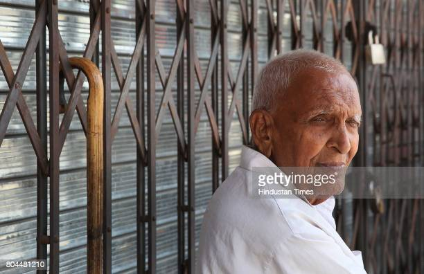 A trader sits outside his shuttered shop as part of the nationwide shutdown to protest GST on June 30 2017 in Jaipur India The traders said they were...