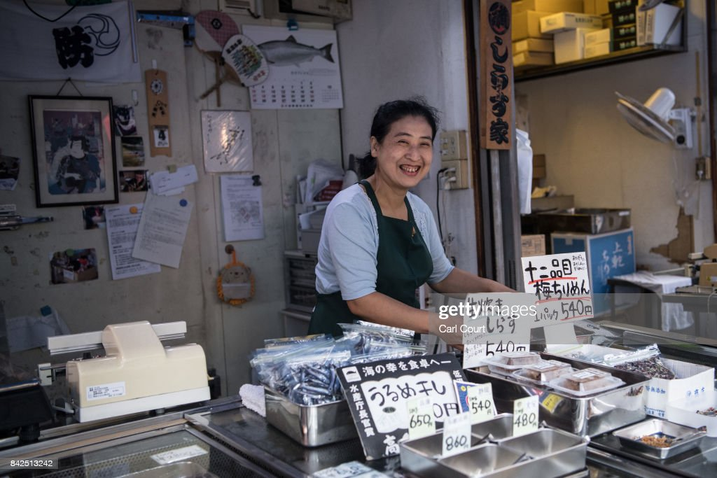 A trader smiles for the camera at her shop in Tsukiji fish market on September 4, 2017 in Tokyo, Japan. The market was built in 1935 following the great Kanto earthquake of 1923 and is now the largest fish market in the world.
