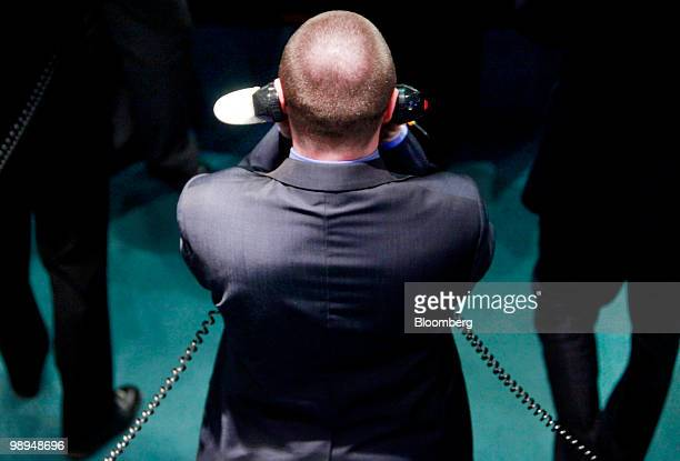 A trader speaks on the telephone while on the floor of the London Metal Exchange in London UK on Monday May 10 2010 The euro rallied and stocks...