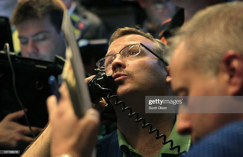 A trader takes an order in the Standard & Poor's 500 stock index options pit at the Chicago Board Options Exchange (CBOE) following the Federal Open Market Committee meeting on January 25, 2012 in Chicago, Illinois. Following the meeting the Fed, which left interest rates unchanged, said it does not plan any rate changes until late 2014.