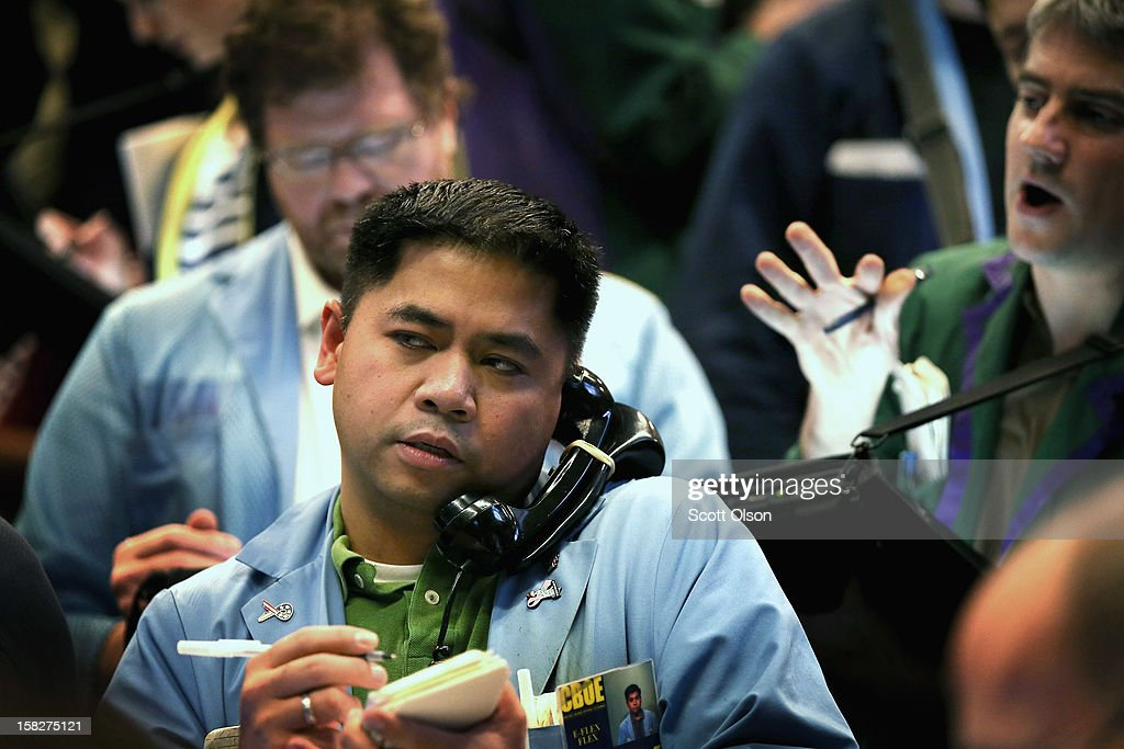 A trader takes orders in the Standard & Poor's 500 stock index options pit at the Chicago Board Options Exchange (CBOE) following the Federal Open Market Committee meeting on December 12, 2012 in Chicago, Illinois. The Fed announced today that they expect to keep a key short-term interest rates at or near zero percent as long as the unemployment rate remains above 6.5 percent. William Brodsky, Chairman and CEO of the CBOE, said that he will step down as CEO following the 2013 Annual Meeting.