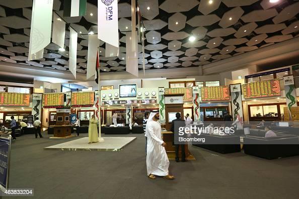 A trader walks across the main hall of the Dubai Financial Market stock exchange in Dubai United Arab Emirates on Tuesday Nov 11 2014 Dubai's index...