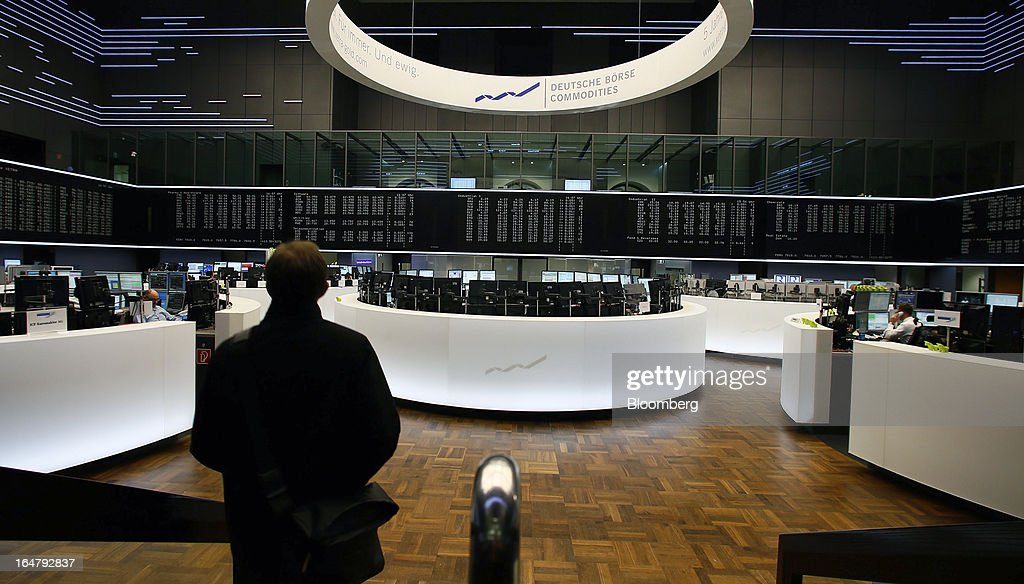 A trader walks across the trading floor at the Frankfurt Stock Exchange in Frankfurt, Germany, on Thursday, March 28, 2013. Cyprus's lenders had been closed since March 16, when the European Union presented a proposal to force losses on all depositors in exchange for a 10 billion-euro bailout. Photographer: Ralph Orlowski/Bloomberg via Getty Images