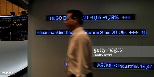 A trader walks across the trading floor of Frankfurt stock exchange on March 21 2007 in Frankfurt Germany The German Stock Exchange has changed its...
