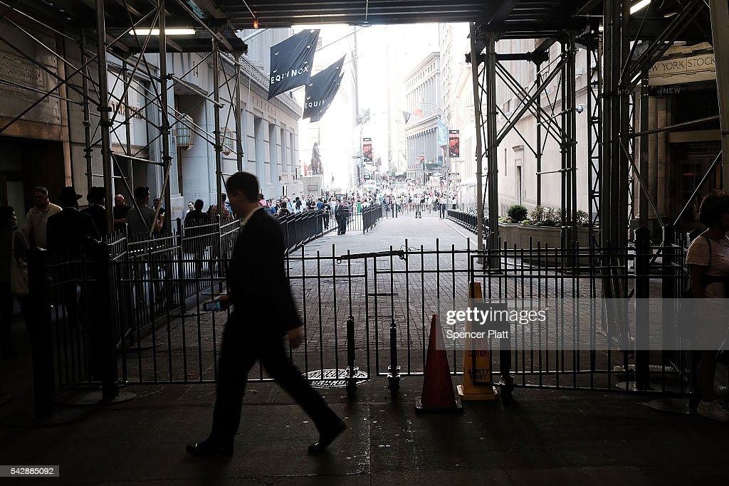 A trader walks out of the New York Stock Exchange (NYSE) on Wall Street following news that the United Kingdom has voted to leave the European Union on June 24, 2016 in New York City. The Dow Jones industrial average closed down over 600 points on the news with markets around the globe pluninging.
