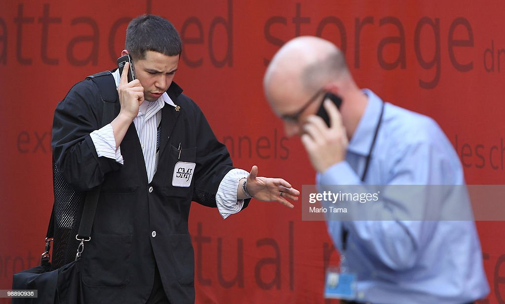 A trader (L) walks outside the New York Stock Exchange before the closing bell May 6, 2010 in New York City. The Dow plunged almost 1000 points before closing down 347 on Greek debt fears.