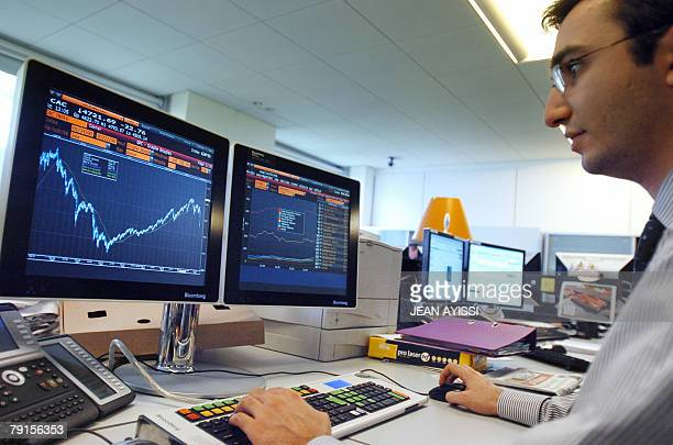 A trader watches the French CAC market curve at the independant private banking company Meeschaert Gestion Privee 22 January 2008 in Paris The French...