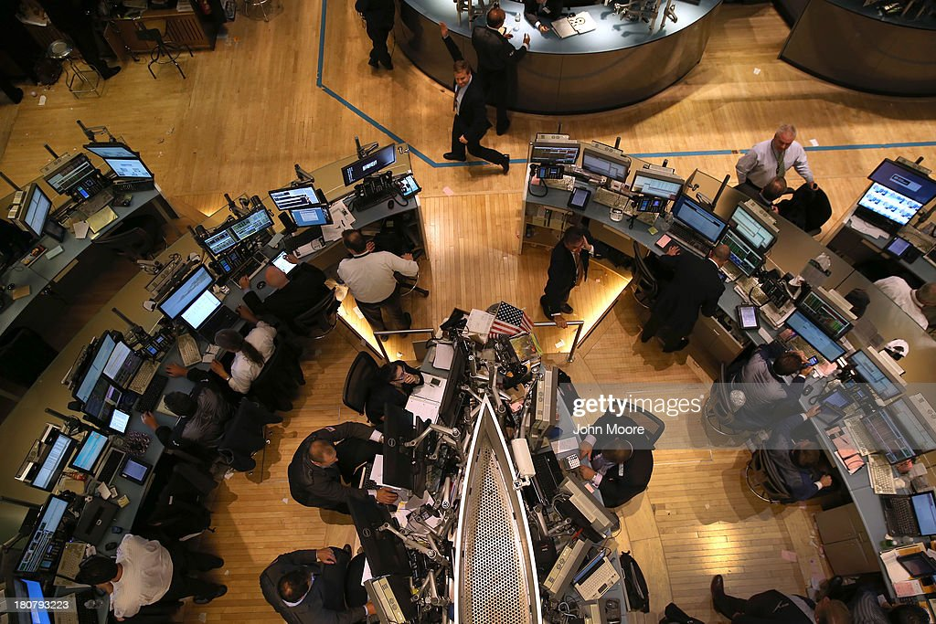A trader waves to colleagues after the closing bell of the New York Stock Exchange on September 16, 2013 in New York City. The Dow Jones Industrial Average traded up 119 points, closing at 15,495. Five years after the beginning of the financlial crisis, Wall Street has more than recovered its losses, although unemployment nationwide remains high.