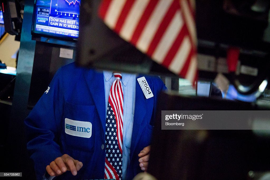 A trader wearing an American flag themed tie works on the floor of the New York Stock Exchange (NYSE) in New York, U.S., on Friday, May 27, 2016. U.S. stocks edged higher, with the S&P 500 on course for its biggest weekly advance since March, while investors awaited remarks from Federal Reserve Chair Janet Yellen for hints on the timing of the next interest-rate increase. Photographer: Michael Nagle/Bloomberg via Getty Images