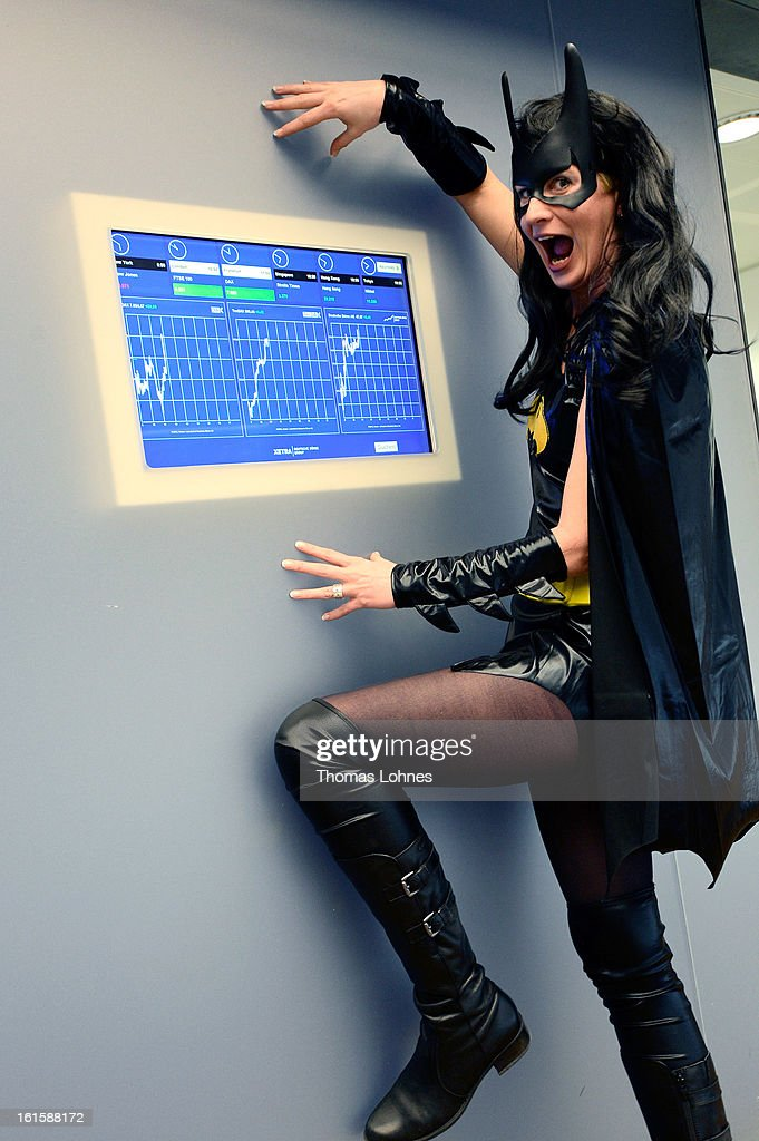 A trader wearing Batwoman costume poses on the trading floor of the Frankfurt Stock Exchange on February 12, 2013 in Frankfurt am Main, Germany. Carnival has been an annual tradition in parts of western Germany since 1823 and workers often celebrate free-spirited merrymaking by wearing carnival fancy dress costumes before the beginning of Lent.
