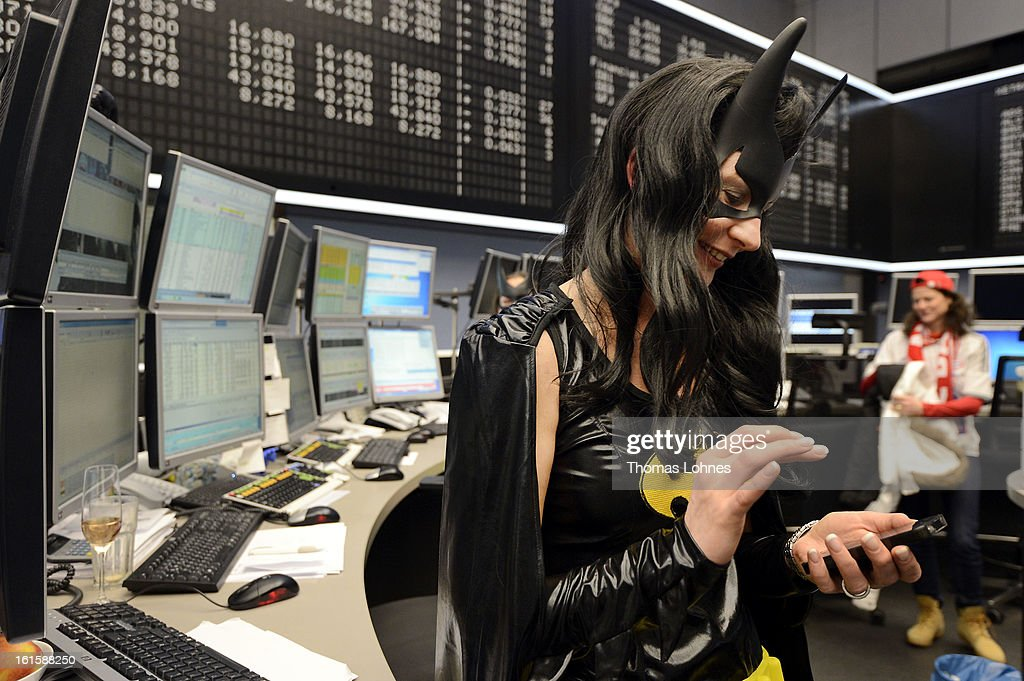 A trader wears a Batwoman costume at work on the trading floor of the Frankfurt Stock Exchange on February 12, 2013 in Frankfurt am Main, Germany. Carnival has been an annual tradition in parts of western Germany since 1823 and workers often celebrate free-spirited merrymaking by wearing carnival fancy dress costumes before the beginning of Lent.